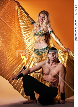 Arabic dancer with a handsome men performing fire show 9269393