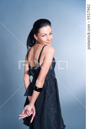 Brunette woman against blue background. 9317962