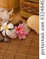 tropical spa setup with frangipani flower hot rocks and massage 9324645