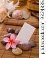 tropical spa setup with frangipani flower hot rocks and massage 9324885