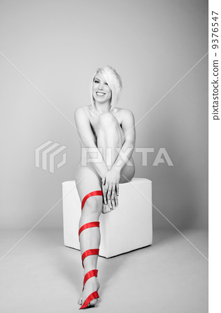 woman wearing nothing but red belt 9376547