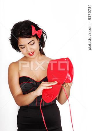 beautiful woman wearing black and red dress 9376784