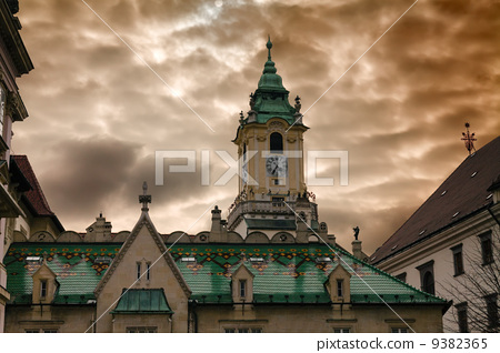 Town hall and dramatic cloudy sky 9382365