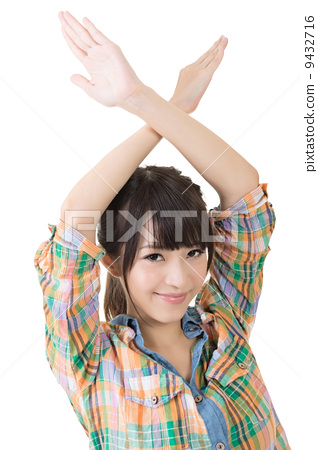 Young asian woman crossed hands overhead 9432716