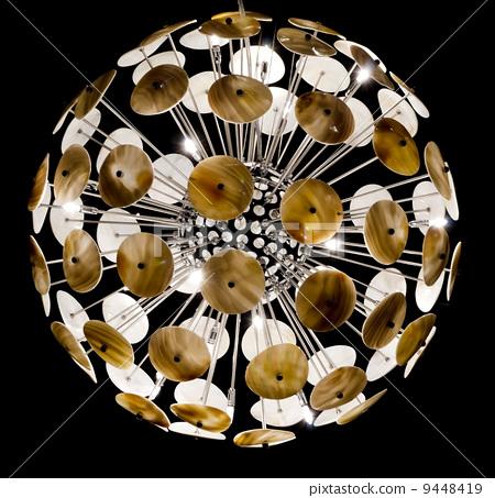 Indoor decorative chandelier shining in the living room 9448419