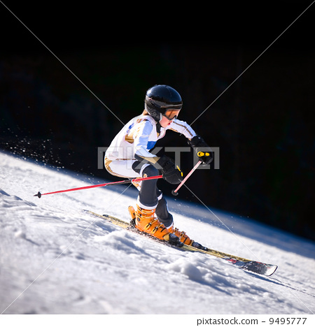 Downhill Skiier 9495777