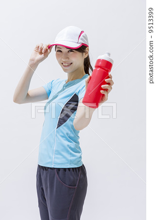 A woman with a sports drink 9513399