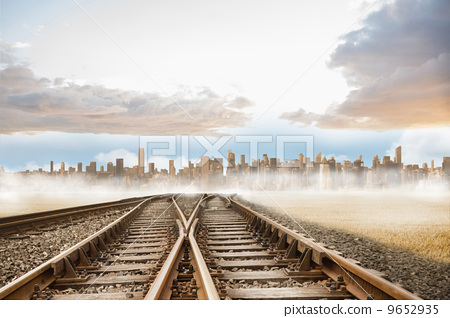 Railway tracks leading to city 9652935