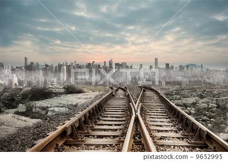 Railway tracks leading to big city 9652995
