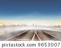 Railway tracks leading to city on the horizon 9653007