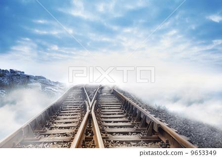 Railway tracks leading to clouds 9653349