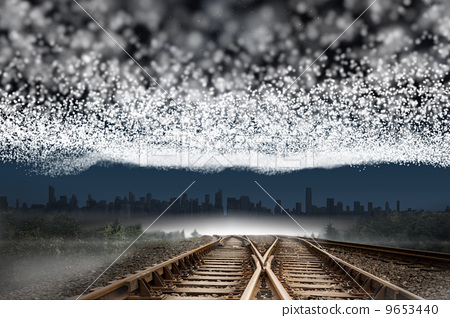 Train tracks leading to city under blanket of stars 9653440