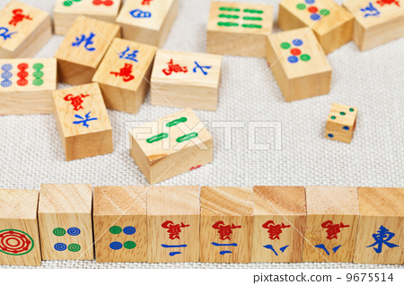 wooden tiles in mahjong game on textile table 9675514