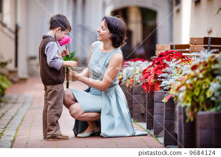 Little boy giving flower to his mom 9684124