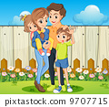 A family at the backyard with a wooden fence 9707715