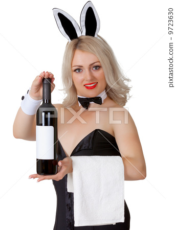 Waitress in bunny suit shows a bottle of wine 9723630