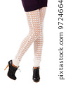 Woman's legs in a knitted leggings 9724664