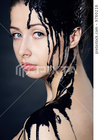 beautiful girl with flowing down the face paint 9760216