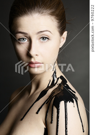beautiful girl with flowing down face paint 9760222