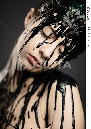 beautiful girl with flowing down face paint 9760224