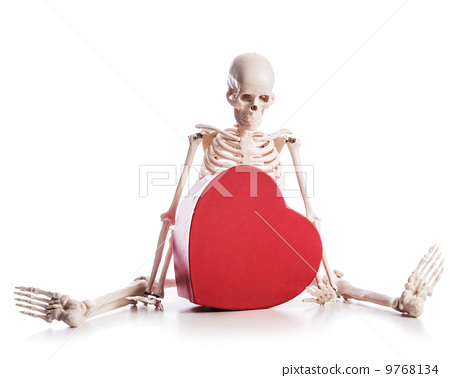 Love concept with skeleton and giftbox 9768134