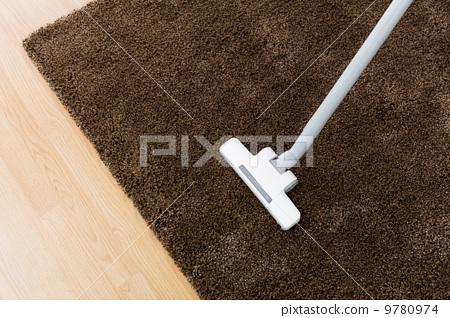 Head of modern vacuum cleaner on carpet 9780974