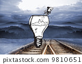 Composite image of fish jumping out of light bulb bowl 9810651