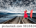 Composite image of elegant blonde holding umbrella 9816824