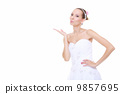 Wedding day. Bride romantic girl blowing a kiss isolated 9857695