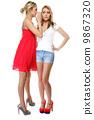 Gossiping friends, two women sharing a secret 9867320