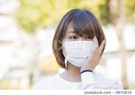 Women in mask shape 9870819