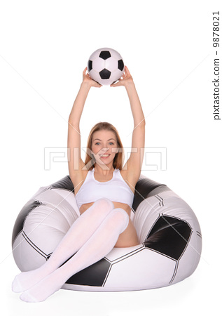 woman with soccer ball on an inflatable chair 9878021