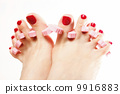 foot pedicure applying red toenails on white 9916883