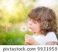 Happy child blowing dandelion 9931959