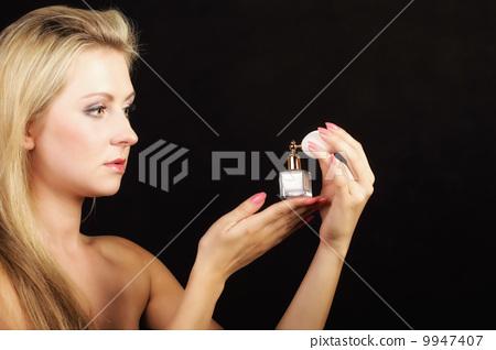 portrait beautiful woman with perfume bottle 9947407