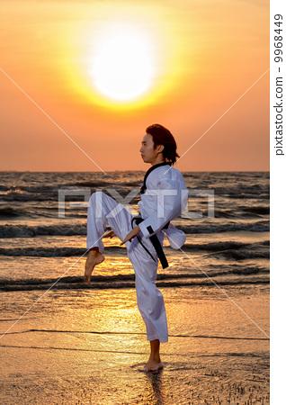 Martial art training at sunset 9968449