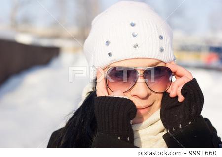 Winter Girl in a sunglasses 9991660