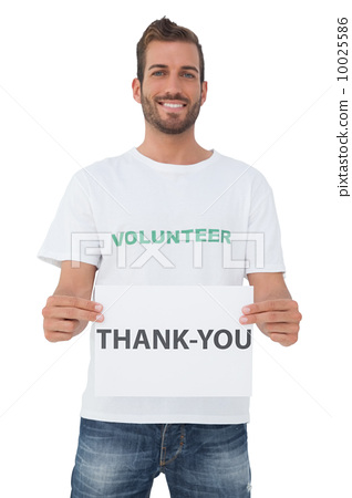 Smiling young male volunteer holding 'thank you' paper 10025586