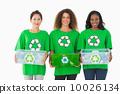 Team of environmental activists holding boxes smiling at camera 10026134