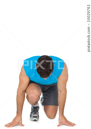 Young sporty man in running stance 10029761