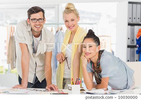 Fashion designers discussing designs 10030000