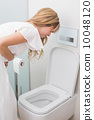 Woman with stomach sickness about to vomit into toilet 10048120