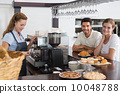 Couple with female cafe owner at coffee shop 10048788