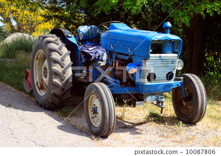 old blue tractor on the road 10087806