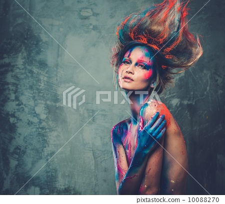 Young woman muse with creative body art and hairdo 10088270