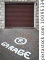 Caution text mark on asphalt in front of closed garage door 10095134