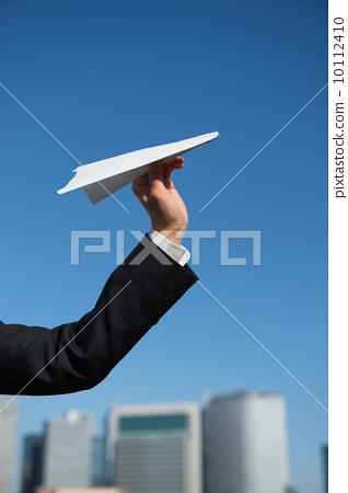 Women's hand with paper airplane 10112410