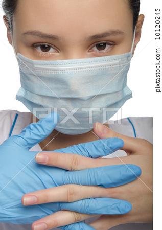 Doctor gloved hands folded 10120245