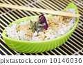 Rice with soy sauce in clay bowl with wooden chopsticks 10146036