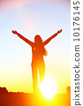 Happy cheering celebrating success woman sunset 10176145